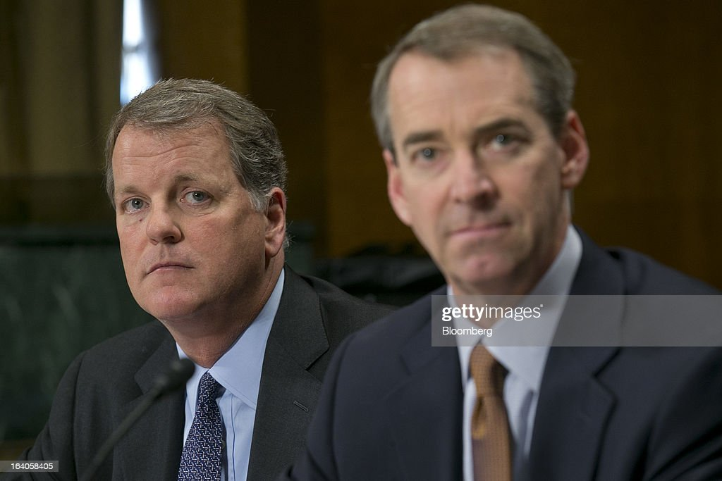 Douglas 'Doug' Parker, chairman and chief executive officer of US Airways Group Inc., left, and Thomas 'Tom' Horton, chairman, president and chief executive officer of AMR Corp.'s American Airlines, listen during a Senate Judiciary Committee hearing in Washington, D.C., U.S., on Tuesday, March 19, 2013. The proposed merger between American Airlines and US Airways would increase fares, reduce service to smaller communities and make it more difficult for low-cost carriers to compete, two consumer advocates said at a Senate hearing. Photographer: Andrew Harrer/Bloomberg via Getty Images