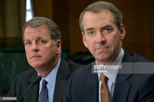 Douglas 'Doug' Parker chairman and chief executive officer of US Airways Group Inc left and Thomas 'Tom' Horton chairman president and chief...
