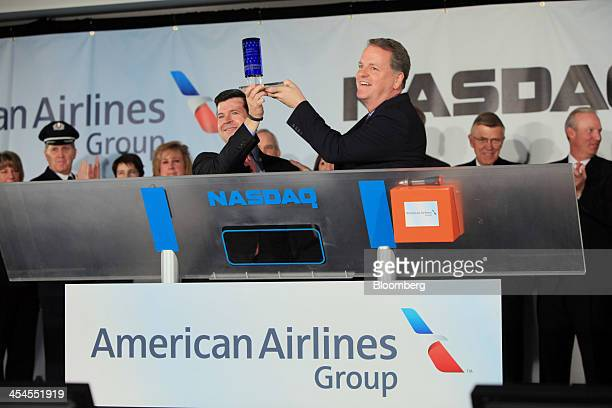 Douglas 'Doug' Parker chief executive officer of the newly formed American Airlines Group Inc right and Robert 'Bob' McCooey senior vice president at...
