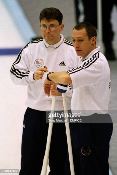 Douglas Dryburgh of Great Britain discusses tactics with teammate Ronnie Napier as Great Britain are on the verge on losing the match