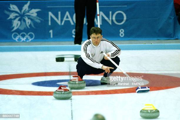 Douglas Dryburgh of Great Britain watches his granite stone curl towards the house