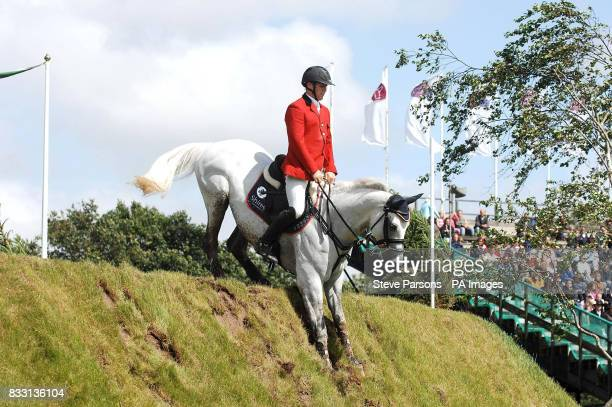 Douglas Duffin from Scotland on board Wonder Van De Roshoeve during DFS Derby at The All England Jumping Course at Hickstead, West Sussex.