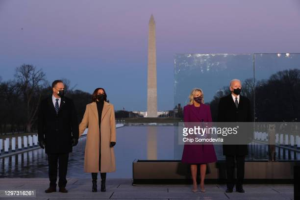 Douglas Emhoff, U.S. Vice President-elect Kamala Harris, Dr. Jill Biden and U.S. President-elect Joe Biden attend a memorial service to honor the...