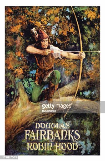 Douglas Fairbanks in a tree with a bow and arrow on a poster that advertises the movie 'Robin Hood' 1922