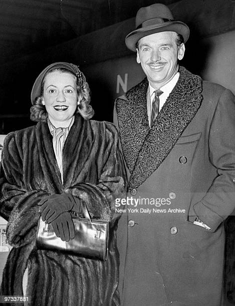 Douglas Fairbanks Jr and his wife arrive aboard the 20th Century Limited