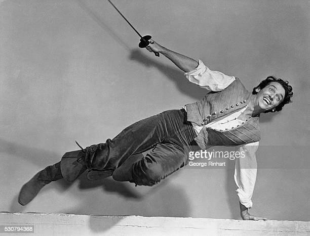 Douglas Fairbanks Jr looking and acting strikingly like his dashing father in a scene from the Universal Production Sinbad the Sailor It was his...