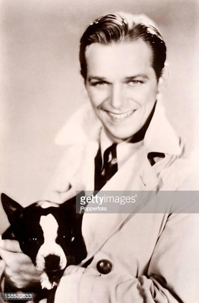 Douglas Fairbanks Junior, actor, with a dog, circa 1922.