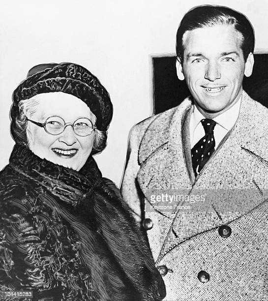 Douglas FAIRBANKS Junior with his mother Mrs. Jack WHITING as they breezed into New York around 1938.