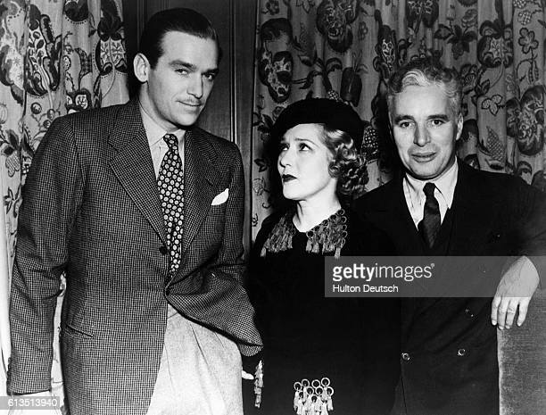 Douglas Fairbanks Junior with his stepmother, Mary Pickford and Charlie Chaplin.
