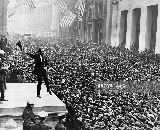 Douglas Fairbanks selling Liberty Loans during the third loan drive at the Sub-Treasury Building. Ca. 1914.