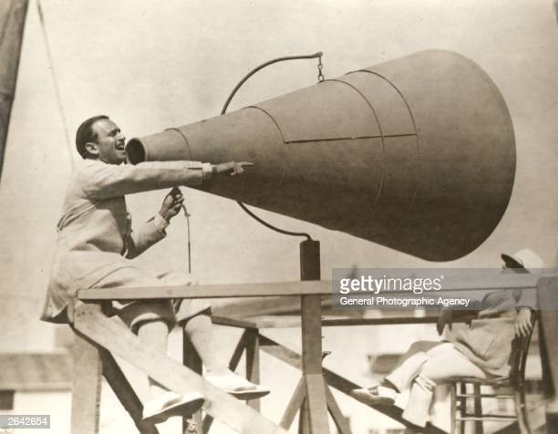 Douglas Fairbanks Snr using a giant megaphone during filming of the United Artists production 'The Gaucho'.