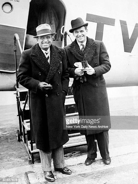 Douglas Fairbanks Sr and Douglas Fairbanks Jr arrive at Newark Airport