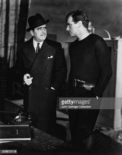 Douglas Fairbanks, Sr. Chats with son, Douglas Fairbanks, Jr., on the set of his son's upcoming film, Jump for Glory, a film directed by Raoul Walsh.