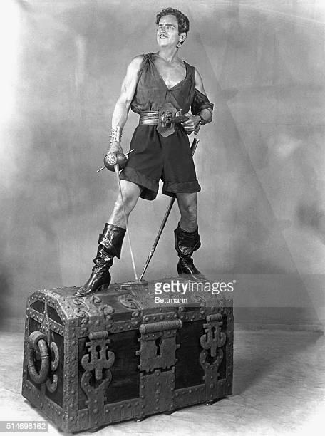 "Douglas Fairbanks, Sr., standing on treasure chest. From ""Black Pirate."" United Artists. Undated. BPA2# 3733"