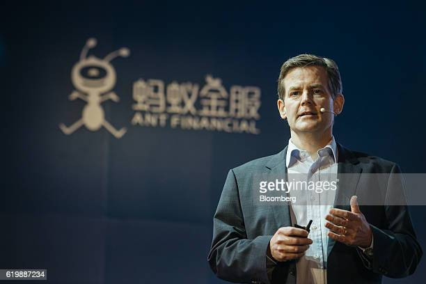 Douglas Feagin head of international operations at Zhejiang Ant Small Micro Financial Services Group Co gestures as he speaks during a news...