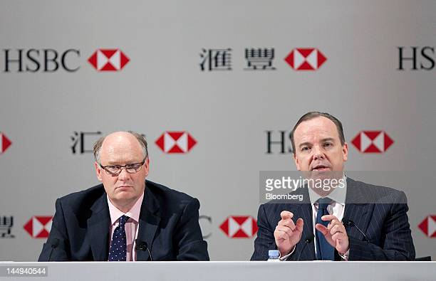 Douglas Flint chairman of HSBC Holdings Plc left listens as Stuart Gulliver group chief executive officer of HSBC Holdings Plc speaks during a news...