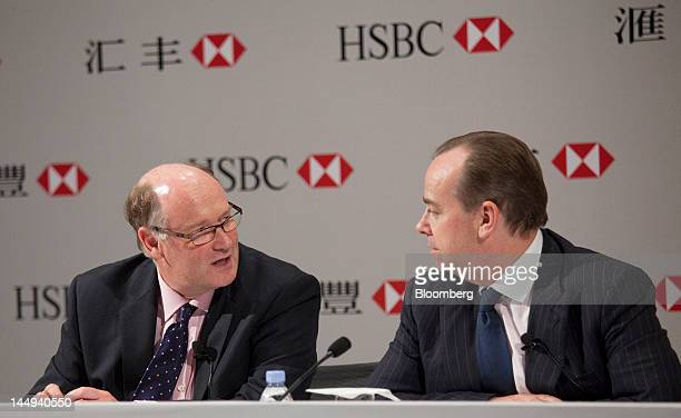 Douglas Flint chairman of HSBC Holdings Plc left speaks with Stuart Gulliver group chief executive officer of HSBC Holdings Plc during a news...