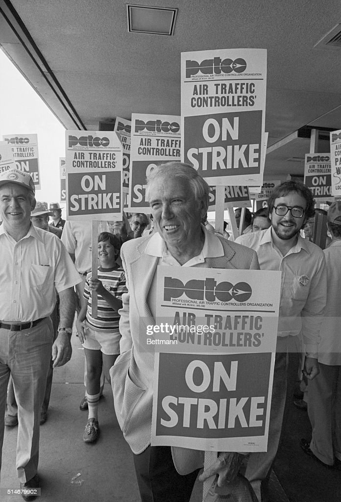 Douglas Fraser, president of the United Auto Workers, joins striking air traffic controllers on their picket line at Detroit Metropolitan Airport. He said that U.A.W. airline workers would strike in solidarity with the controllers. | Location: Detroit Metropolitan Airport, Detroit, Michigan, USA.