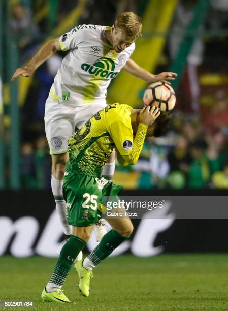Douglas Grolli of Chapecoense heads the ball with Agustin Bouzat of Defensa y Justicia during a first leg match between Defensa y Justicia and...