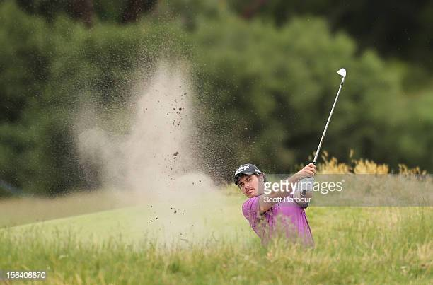 Douglas Holloway of New Zealand plays out of a bunker during day one of the Australian Masters at Kingston Heath Golf Club on November 15, 2012 in...