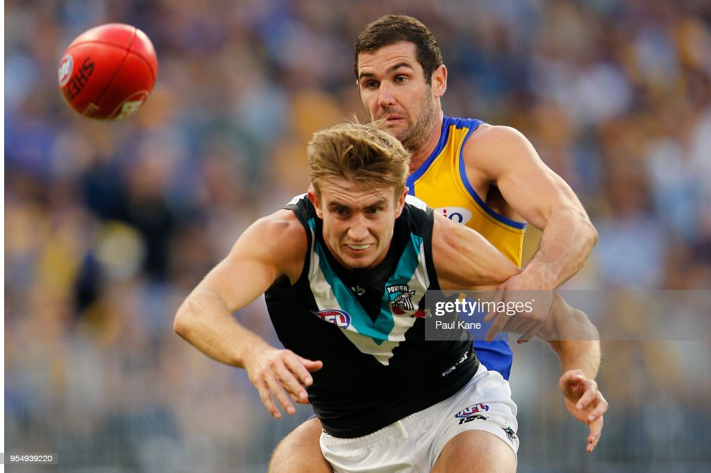 Douglas Howard of the Power and Jack Darling of the Eagles contest for the ball during the round seven AFL match between the West Coast Eagles and the Port Adelaide Power at Optus Stadium on May 5, 2018 in Perth, Australia.