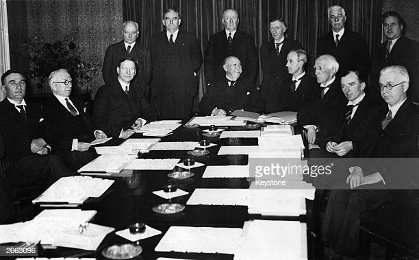 Douglas Hyde Irish historian, writer, poet and President of Ireland sitting at the head of the table. With him are Eamon de Valera, Sean T O'Kelly,...