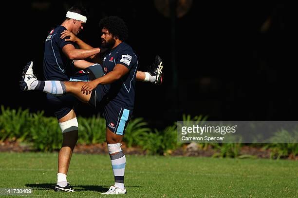 Douglas Kane and Tatafu PolotaNau of the Waratahs stretch during a Waratahs Super Rugby training session at Victoria Barracks on March 23 2012 in...