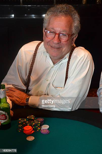 Douglas Kass, president of Seabreeze Partners Management Inc. President, plays a card game at the Reach poker tournament at Gotham Hall in New York,...