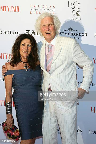 Douglas Kirkland and wife attend the opening of ' Douglas Kirkland a Life in Pictures' Exhibition at Telecom Future Center on August 29 2014 in...