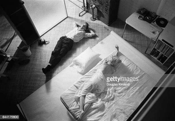 Douglas laying next to Marilyn Monroe after photographing her in Hollywood CA November 1961