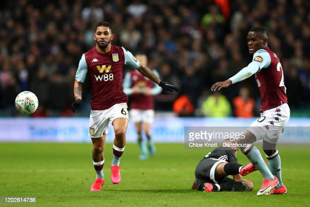 Douglas Luiz and Mbwana Samatta of Aston Villa and Youri Tielemans of Leicester City in action during the Carabao Cup Semi Final match between Aston...