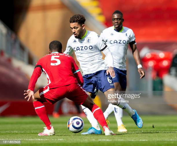 Douglas Luiz of Aston in action during the Premier League match between Liverpool and Aston Villa at Anfield on April 10, 2021 in Liverpool, England....