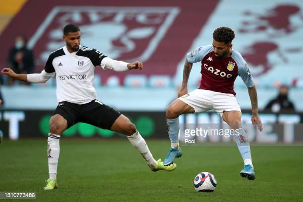 Douglas Luiz of Aston Villa and Ruben Loftus-Cheek of Fulham battle for possession during the Premier League match between Aston Villa and Fulham at...