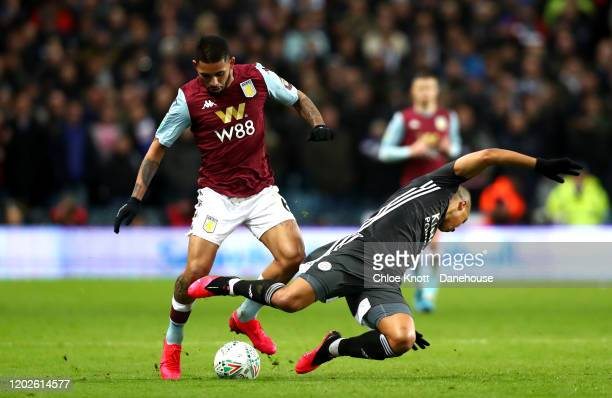 Douglas Luiz of Aston Villa and Youri Tielemans of Leicester City in action during the Carabao Cup Semi Final match between Aston Villa and Leicester...