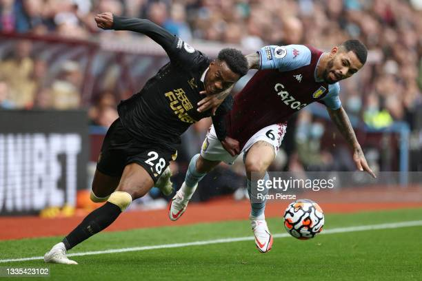 Douglas Luiz of Aston Villa battles for possession with Joe Willock of Newcastle United during the Premier League match between Aston Villa and...
