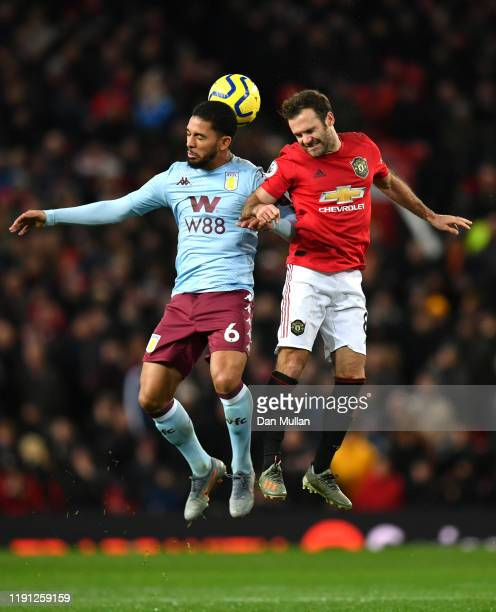 Douglas Luiz of Aston Villa battles for possession with Juan Mata of Manchester United during the Premier League match between Manchester United and...