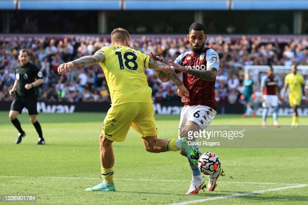 Douglas Luiz of Aston Villa battles for possession with Pontus Jansson of Brentford during the Premier League match between Aston Villa and Brentford...