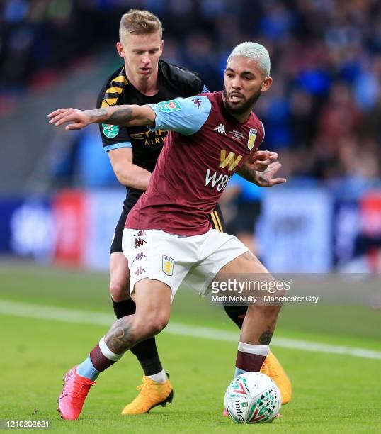 Douglas Luiz of Aston Villa battles with Oleksandr Zinchenko of Manchester City during the Carabao Cup Final between Aston Villa and Manchester City...