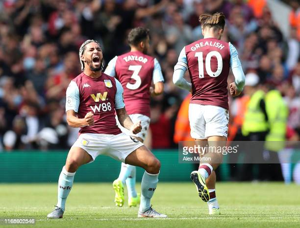 Douglas Luiz of Aston Villa celebrates after scoring his team's first goal during the Premier League match between Aston Villa and AFC Bournemouth at...