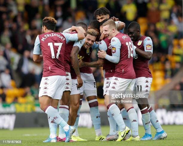 Douglas Luiz of Aston Villa celebrates with teammates after scoring his team's fifth goal during the Premier League match between Norwich City and...