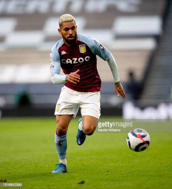Douglas Luiz of Aston Villa in action during the Premier League match between Tottenham Hotspur and Aston Villa at Tottenham Hotspur Stadium on May...