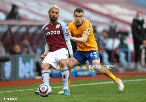 Douglas Luiz of Aston Villa is challenged by Seamus Coleman of Everton during the Premier League match between Aston Villa and Everton at Villa Park...