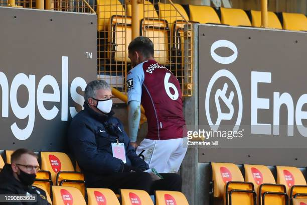 Douglas Luiz of Aston Villa leaves the pitch after receiving a red card during the Premier League match between Wolverhampton Wanderers and Aston...