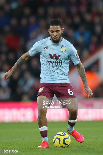 Douglas Luiz of Aston Villa passes the ball during the Premier League match between AFC Bournemouth and Aston Villa at Vitality Stadium on February...