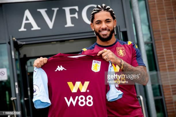 Douglas Luiz of Aston Villa poses for a picture at the Aston Villa Bodymoor Heath training ground on August 07 2019 in Birmingham England