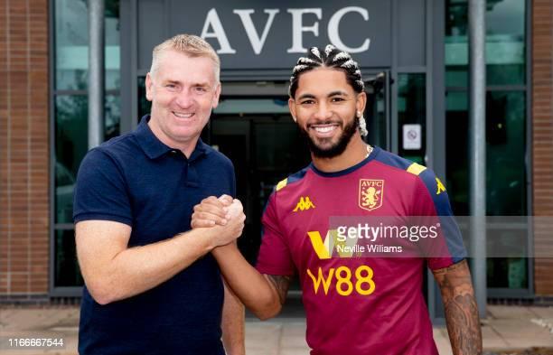 Douglas Luiz of Aston Villa poses for a picture with Dean Smith head coach of Aston Villa at the Aston Villa Bodymoor Heath training ground on August...