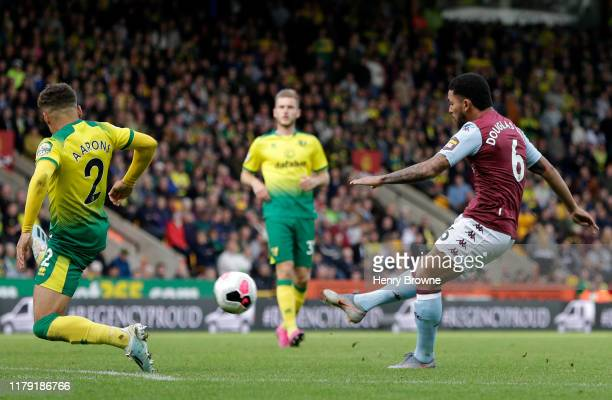 Douglas Luiz of Aston Villa scores his sides 5th during the Premier League match between Norwich City and Aston Villa at Carrow Road on October 05,...