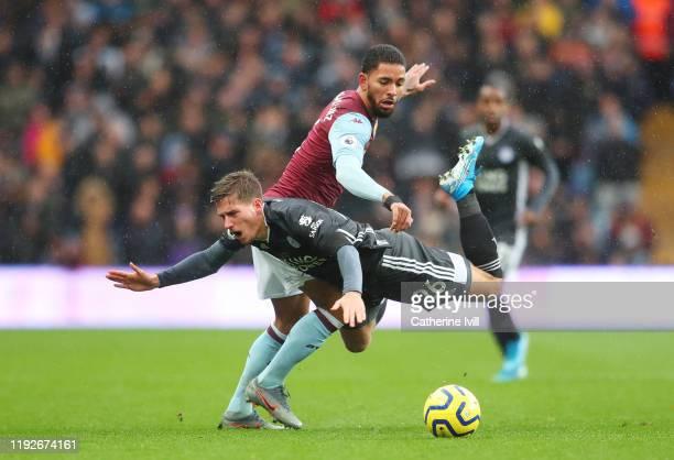 Douglas Luiz of Aston Villa tackles Dennis Praet of Leicester City during the Premier League match between Aston Villa and Leicester City at Villa...