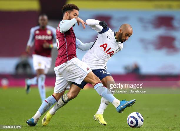 Douglas Luiz of Aston Villa tackles Lucas Moura of Tottenham Hotspur during the Premier League match between Aston Villa and Tottenham Hotspur at...