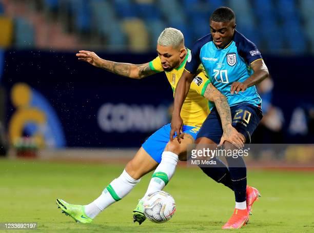 Douglas Luiz of Brazil competes for the ball with Sebastian Mendez of Ecuador during a group B match between Brazil and Ecuador as part of Copa...
